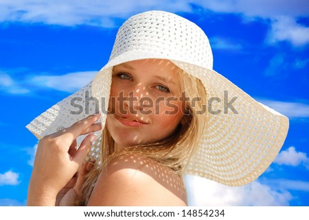 Young girl under hat in summer - stock photo