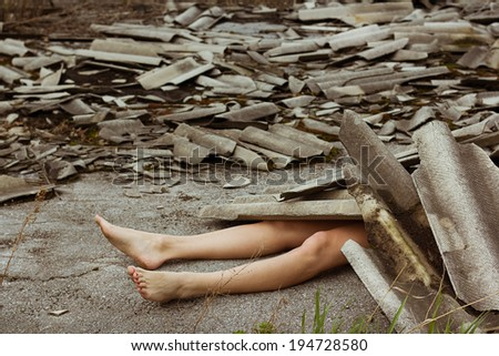 Young girl under roof of ruin house under strong wind. - stock photo