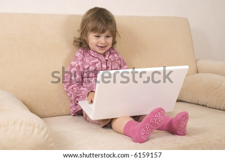 young girl using a laptop. computer generation