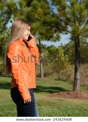 Young girl using her mobile phone. - stock photo