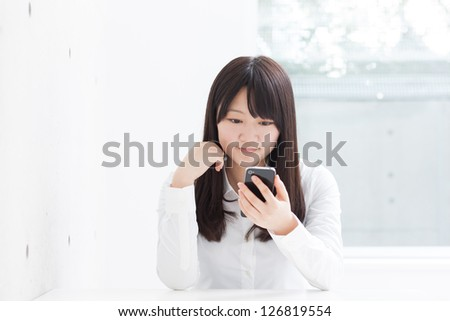 young girl using smart phone - stock photo