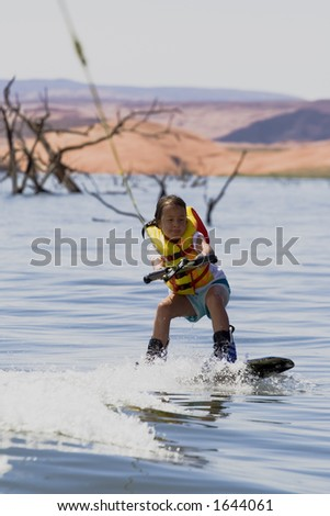 Young girl wakeboarding at Lake Powell, Glen Canyon National Recreation Area Utah USA - stock photo