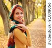 young girl walking in autumn park - stock photo
