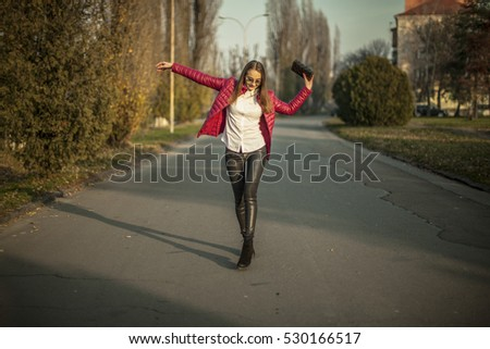 Young girl walking in red top