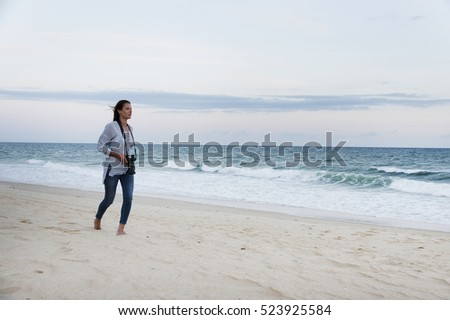 Young girl walking on the beach in Algarve, Portugal, Europe