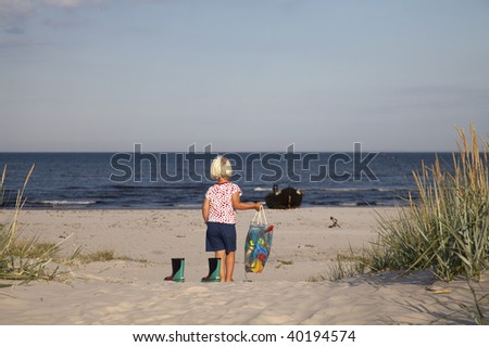 young girl walking to the beach