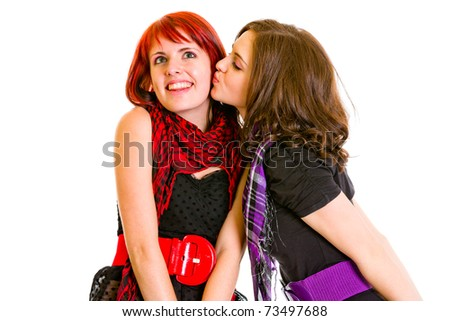 Young girl want to kiss her charming girlfriend isolated on white - stock photo