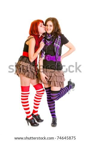 Young girl wants to kiss her charming girlfriend isolated on white - stock photo