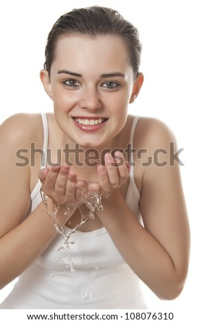 young girl washing her face - white background