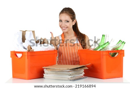 Young girl waste sorting isolated on white - stock photo