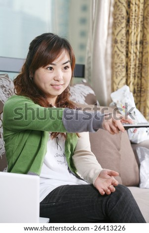 young girl watch TV  at home