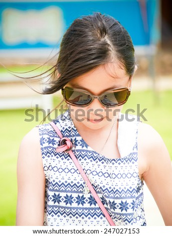 young girl wear glasses not look at camera