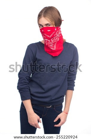 Young girl wearing a scarf over her face like a bandit  isolated - stock photo