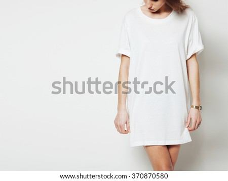 Young girl wearing blank long vest and digital watch. White background - stock photo