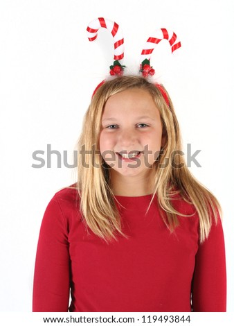 Young girl wearing candy cane head piece ready for Christmas - stock photo