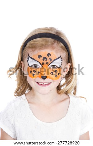 Young girl wearing cheetah carnival face paint isolated on white - stock photo