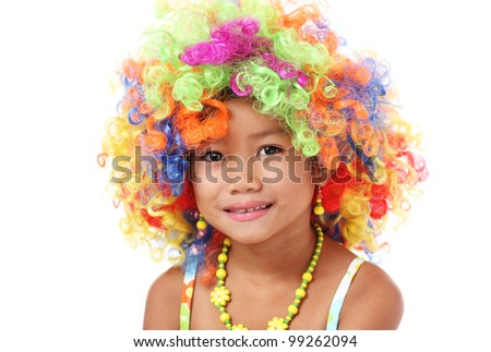 Young girl wearing funny colorful wig.Isolated in white background. - stock photo