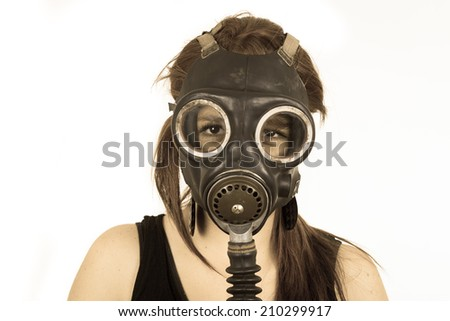 Young girl wearing gas mask isolated on white color toned