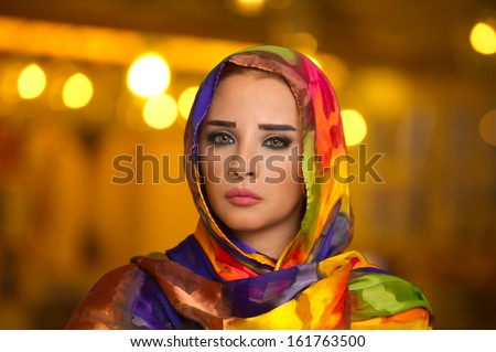Young girl wearing hijab against bokeh lights  - stock photo