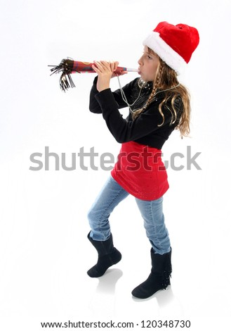 Young girl wearing santa hat with festive horn for Christmas or New Years