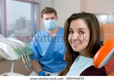 young girl with a beautiful smile on dental checkups - stock photo