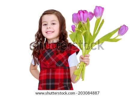 young girl with a bouquet of flowersfloral bouquet, flowers delight,happiness concept,happy childhood,carefree childhood,active lifestyle