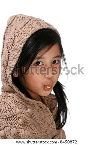 Young girl with a bubblegum in her mouth - stock photo