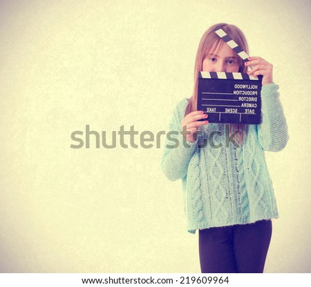 Young girl with a clapboard - stock photo
