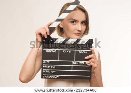 young girl with a clapperboard cinema - stock photo