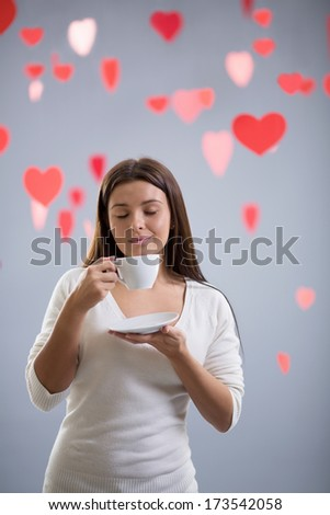 Young girl with a cup - stock photo