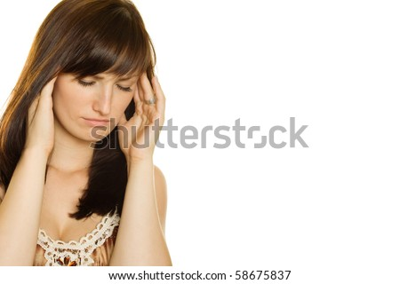 Young girl with a headache on white background - stock photo