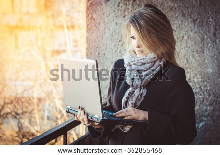 Young girl with a laptop,horizontal photo