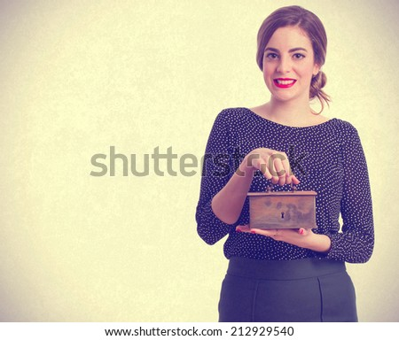 Young girl with a money box - stock photo