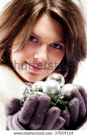 young girl with a New Year's decorations in the hands of