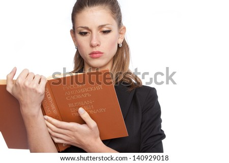 young girl with a Russian-English dictionary