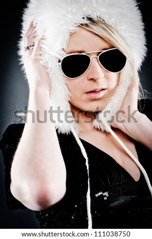 young girl with a skin cape and sunglasses - stock photo