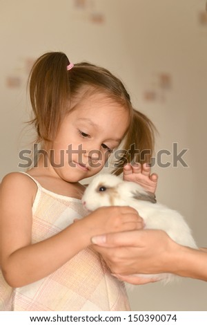 young girl with a small rabbit