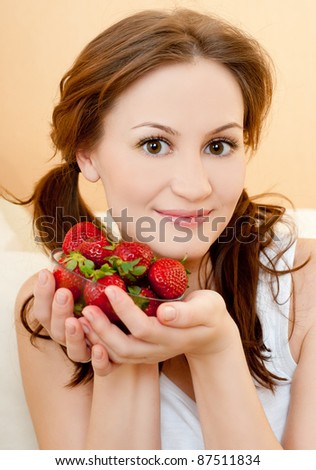 young girl with a strawberry