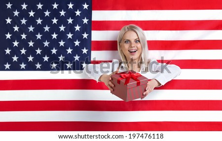 Young girl with an American flag and a gift - stock photo