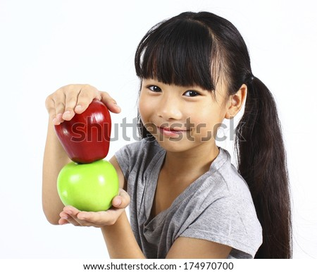 Young girl with apple  - stock photo