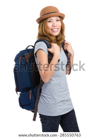 Young girl with backpack and summer hat