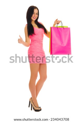 Young girl with bags shows ok gesture isolated - stock photo