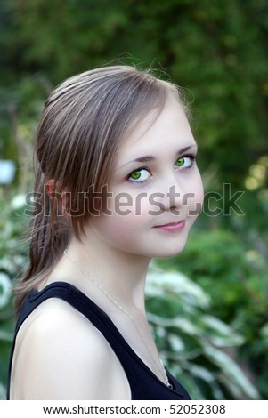 young girl with beautiful green eyes - stock photo
