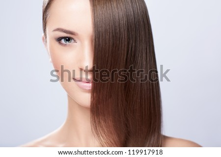 Young girl with beautiful hair in studio - stock photo