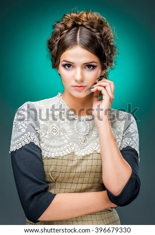young girl with beautiful hairstyle and makeup