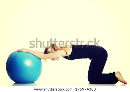 Young girl with big blue fit ball