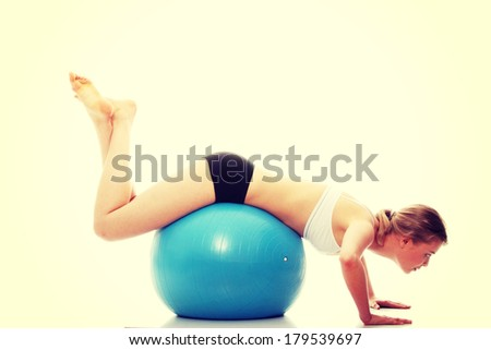 Young girl with big blue fit ball,