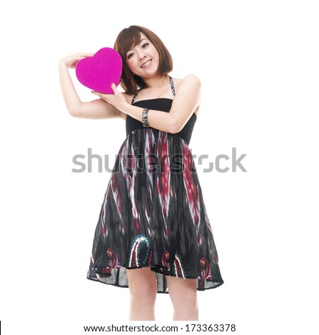 Young Girl with big heart red gift box - stock photo
