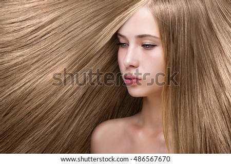 young girl with blonde shining hair