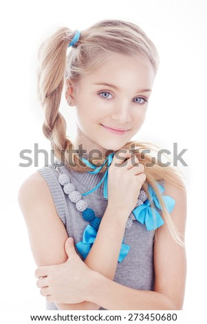 Young girl with blue eyes posing on white background - stock photo